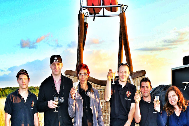 A champagne sunset toast to a successful flight in our Hot Air Balloon